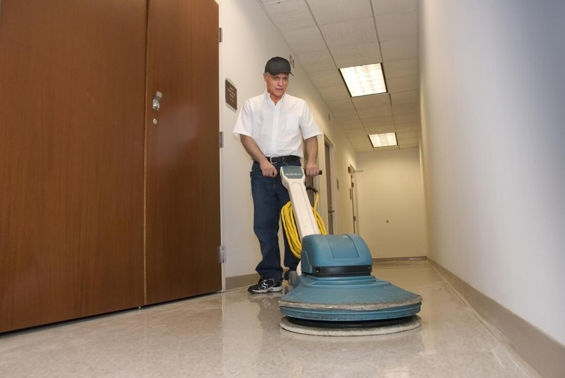 man using a vacuum cleaner